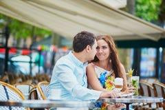 Romantic loving couple in Parisian cafe Stock Photography