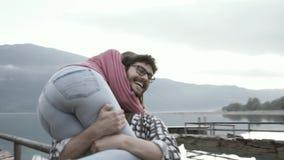 Romantic loving couple spending time at the lake