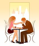 Romantic lunch. Man kissing his girlfriends hand in a lunch Royalty Free Stock Image