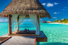 Romantic and luxurious overwater spa with tropical lagoon view Royalty Free Stock Photography
