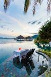 Romantic dinner. Romantic luxury dinner setting at tropical resort on sunset Stock Photography