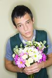 Romantic man with bouquet Royalty Free Stock Image