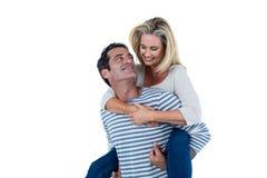 Romantic man carrying woman piggyback Stock Photo