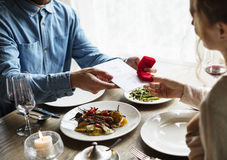 Romantic Man Giving a Ring to Propose Woman on a Date stock photography
