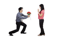 Romantic Man Giving Roses to his Girlfriend Royalty Free Stock Photo