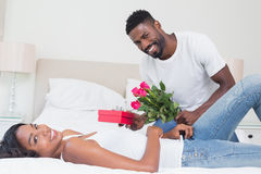 Romantic man giving roses to partner Royalty Free Stock Photos