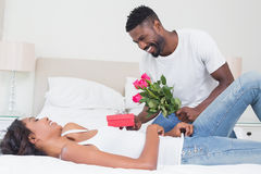 Romantic man giving roses to partner Royalty Free Stock Image