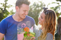 Romantic Man Giving Woman Bunch Of Flowers Royalty Free Stock Photo