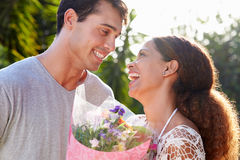 Romantic Man Giving Woman Bunch Of Flowers Royalty Free Stock Photos