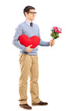Romantic man holding a bouquet of flowers Royalty Free Stock Photos