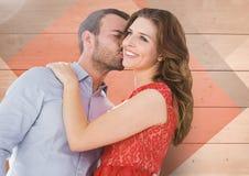 Romantic man kissing on woman cheeks Stock Images