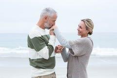 Romantic man kissing womans hand Royalty Free Stock Photos