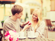 Romantic man proposing to beautiful woman Stock Image