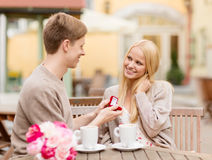 Romantic man proposing to beautiful woman Stock Photography