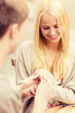Romantic man proposing to beautiful woman Royalty Free Stock Image