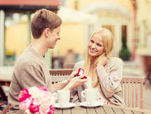 Romantic man proposing to beautiful woman Stock Images