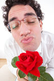 Romantic man with rose giving a kiss Stock Photos