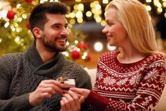 Romantic man suprise woman with gift for Christmas. Romantic men suprise women with gift for Christmas holiday Stock Photo