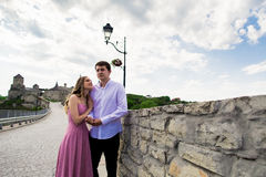 Romantic man and woman couple on Bridge with ancient castle in the background Stock Images