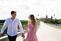 Romantic man and woman couple on Bridge with ancient castle in the background Stock Photo