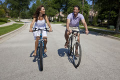 Romantic Man and Woman Couple Cycling Together stock images
