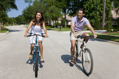 Romantic Man and Woman Couple Cycling Together Stock Photo