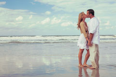 Romantic Man and Woman Couple Kissing On A Beach Stock Photography