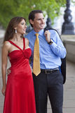 Romantic Man & Woman Couple in London, England. Romantic man and woman couple walking by the River Thames in London, England, Great Britain Stock Photography