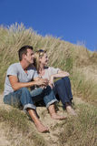 Romantic Man & Woman Couple Sitting On Beach Royalty Free Stock Photo