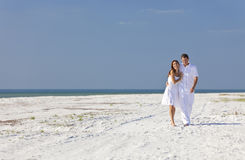 Romantic Man & Woman Couple Walking on An Beach Stock Photos