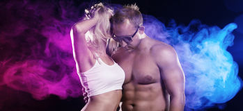 Romantic man and woman dancing in a club Stock Photography