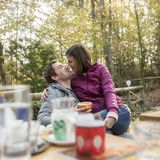 Romantic man and woman sitting on an outdoor patio Stock Photography