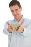 Romantic man with a woven heart of twigs Stock Image