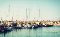 Romantic marina with yachts. retro filtered image Royalty Free Stock Photo