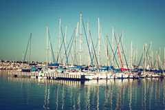 Romantic marina with yachts. retro filtered image Stock Photography
