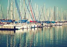 Romantic marina with yachts. retro filtered image Royalty Free Stock Photos