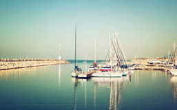Romantic marina with yachts. retro filtered image Royalty Free Stock Photography