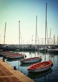 Romantic marina with yachts. retro filtered image Stock Photos