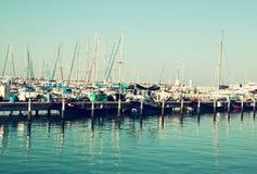 Romantic marina with yachts. retro filtered image Royalty Free Stock Image