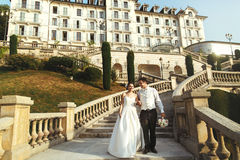 Romantic married couple bride and groom walking down stairs hote Royalty Free Stock Image