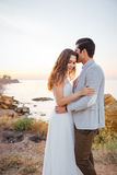 Romantic married couple kissing and hugging on the beach Stock Images