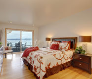 Romantic master bedroom interior with walkout deck Royalty Free Stock Photo