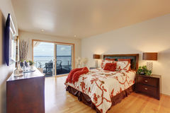 Romantic master bedroom interior with walkout deck Royalty Free Stock Images