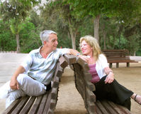 Romantic mature couple. Sitting on a bench Royalty Free Stock Images