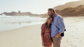 Romantic mature couple on the beach royalty free stock photography