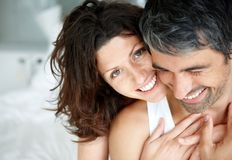 Romantic mature couple enjoying themselves on bed Royalty Free Stock Photography