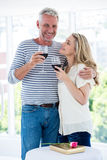 Romantic mature couple with red wine Royalty Free Stock Images
