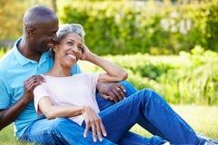 Romantic Mature Couple Sitting In Garden Royalty Free Stock Photos