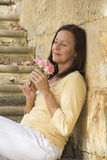 Romantic mature woman in love with rose Stock Photos