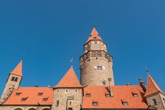 Romantic Medieval Castle `Bouzov`, Czech Republic and a background of the blue sky. The orange roof and blue sky makes nice contrast. Located in the South stock photo